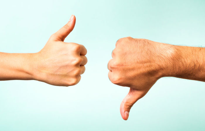 A hand giving a thumbs up and a hand giving a thumbs down.