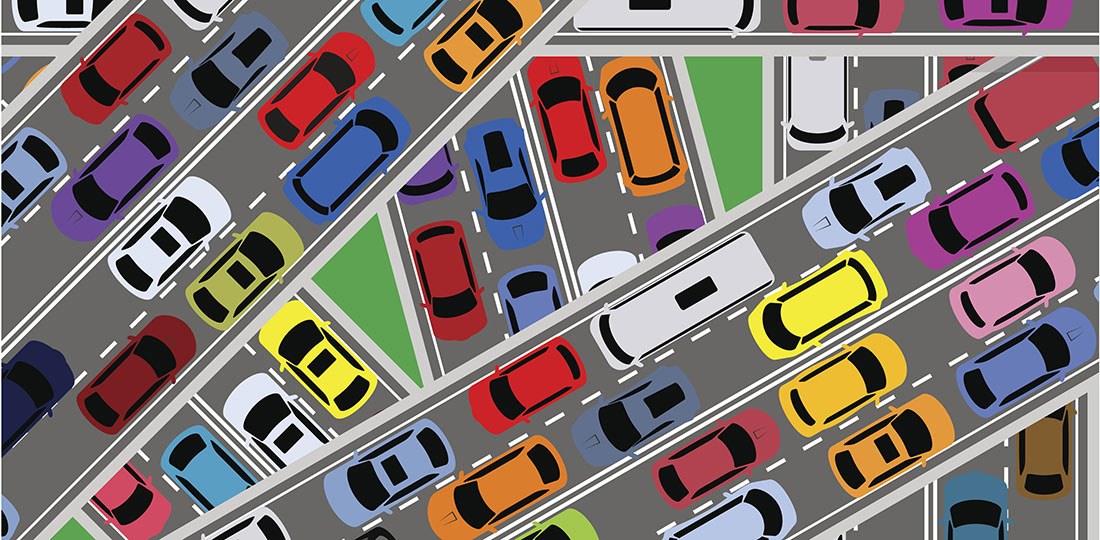 Bumper-to-bumper traffic at a freeway interchange. Illustration.