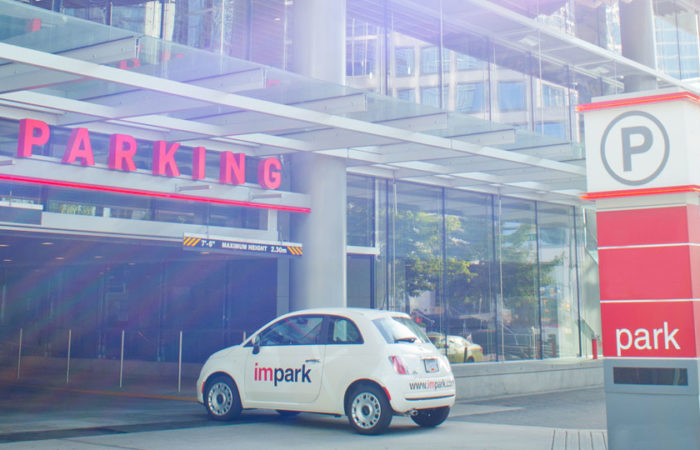 An Impark-branded Fiat 500 entering a well-kept, Impark-managed parking facility.