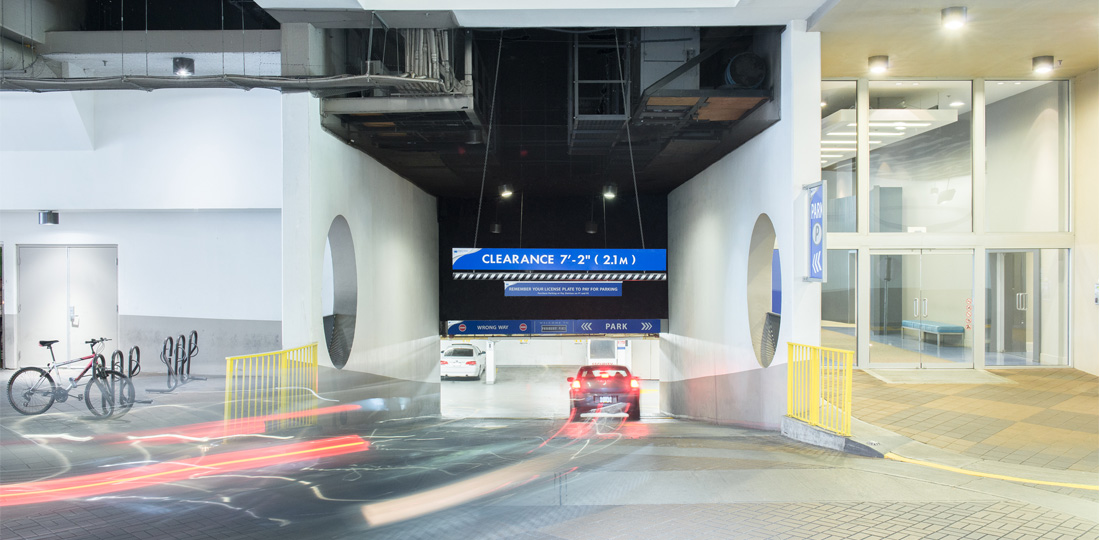 A car enters a gateless underground parking facility.
